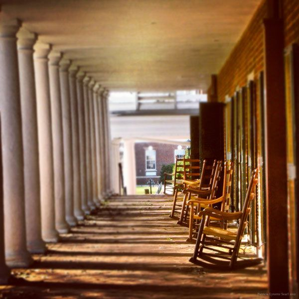 Rocking chairs outside residences on the Lawn at the University of Virginia