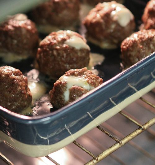 mozzerella stuffed meatballs.  ground meat, panko crumbs, egg, onion, garlic, tabasco or other spice.  make meatball ball, open it up and put in little mozzerella ball.  make sure mozzerella ball is 100% enclosed in meatball, then bake at 350 degrees for 30-35 minutes.