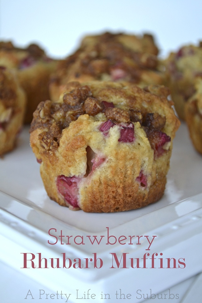Strawberry Rhubarb Muffins {A Pretty Life} - Greek yogurt and the sweet & tart fruit makes these muffins extra moist, and the delicious Pecan Streusel topping makes them perfect to eat from breakfast through to dessert!