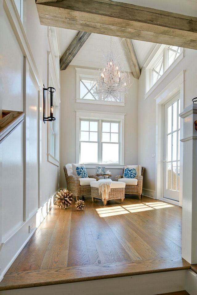 Upper Landing Featuring Exposed Beams And French Doors Leading To