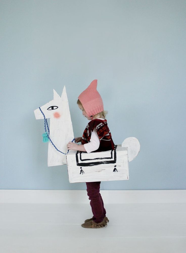 I've wanted to make a costume version of our Toilet Paper Roll Llama Craft ever since I made the little guys. And this year, with our Playful Cardboard Costume Contest, I thought it the perfect time t