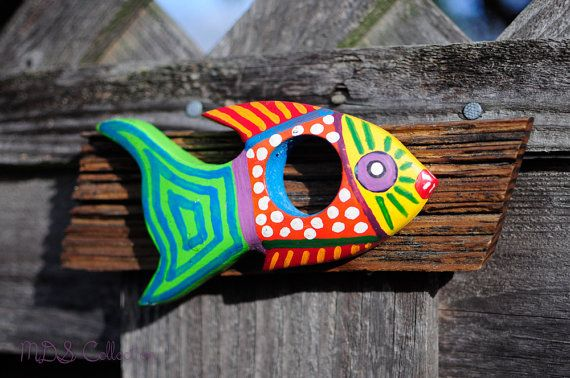 Hey, I found this really awesome Etsy listing at https://www.etsy.com/listing/127322771/mounted-folk-art-fish-with-hole