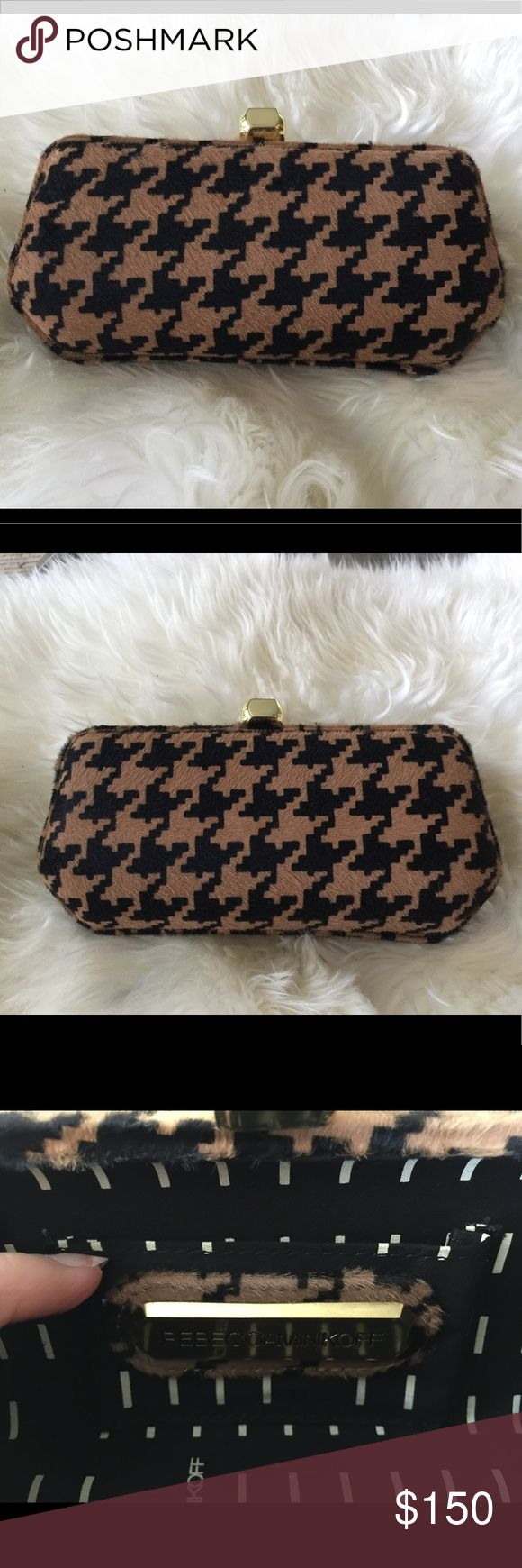 "Rebecca Minkoff minaudiere houndstooth clutch So fab! Hair on hide houndstooth print black and camel clutch. Gold clasp and strap - the strap can hod inside or you can take it off completely. Minor scratches on the clasp - see photo. 8.5"" W at the widest, 4""H, 2.25""D at the deepest. Strap hangs 22.5""L. Non smoking home. Very clean. Rebecca Minkoff Bags Clutches & Wristlets"