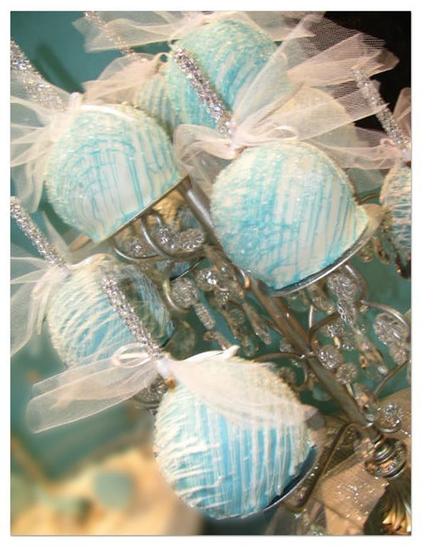 blue chocolate covered apples with bejeweled sticks!  It's the bejeweled sticks that got me!