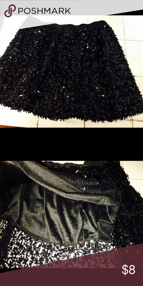 Black sequin skirt New without tag! Black sequin skirt with an elastic band so it can be used as a high waisted skirt too! :) Skirts