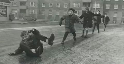 Children playing outside Kevin Street flats in Dublin, Ireland.