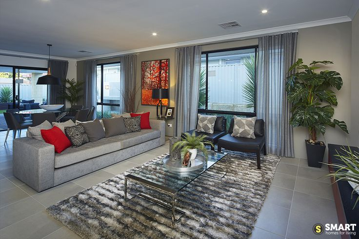 The open plan living room flows effortlessly into the dining and alfresco areas.