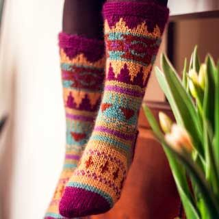 Free knitting pattern for a pair of top-down, stranded socks using an aran weight yarn with a heel flap. Given in three adult sizes for flexibility.