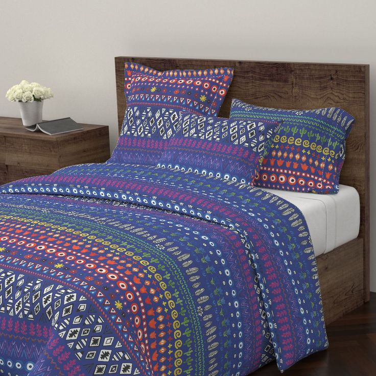 Wyandotte Duvet Cover featuring Bohemian Rainbow - on blue by cecca | Roostery Home Decor