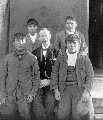 Mr. Pringle with young Yahgan men