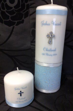 Creations by Jas. Can have white spotty paper and blue ribbon. $40 for med candle, $60 for large.