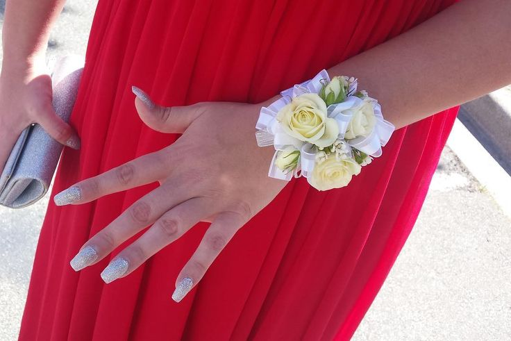 One of our corsages that went out for grad, photo shared by one of our customers!