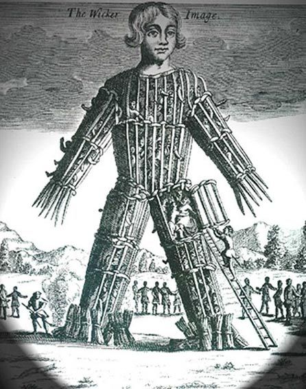 Another 18th century engraving of a wicker man filled with people.