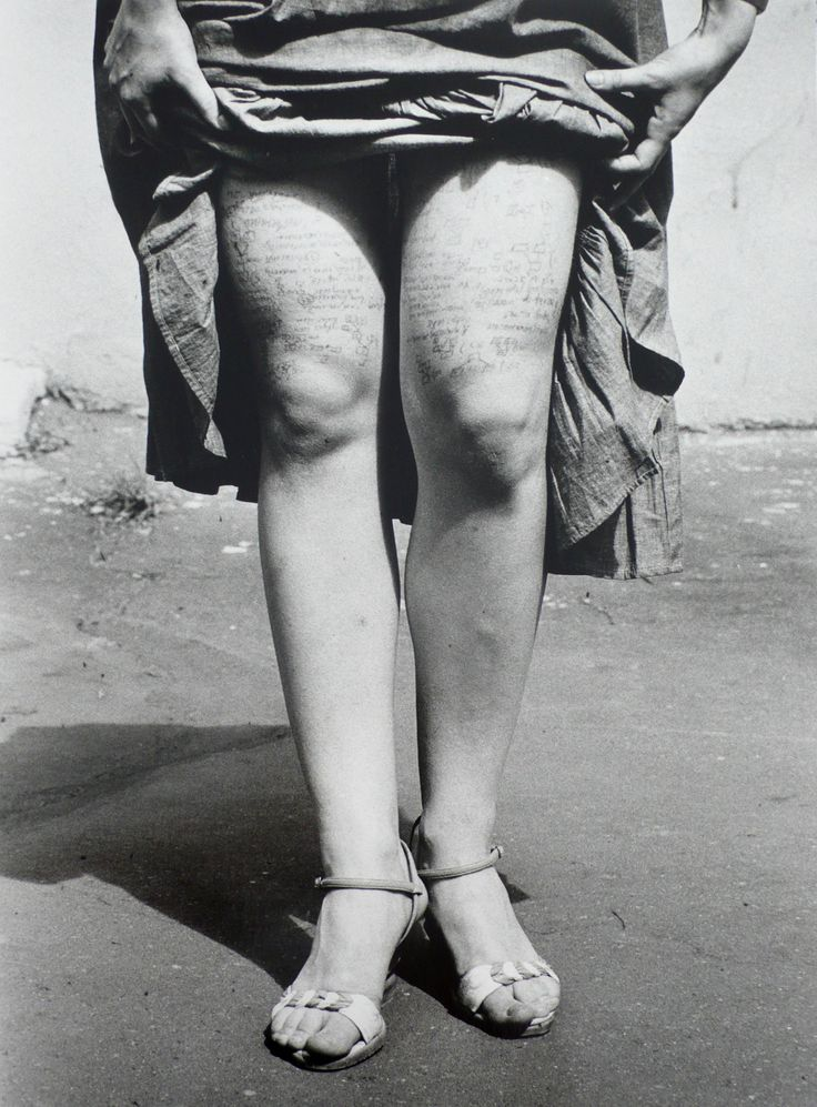 Valery Khristoforov :: A young woman with cheat notes on her thighs, in a photograph titled Cribs, taken at the faculty of journalism of Moscow State University, 1984. / Seeing is believing: documentary photography from Francis Bacon to 9/11