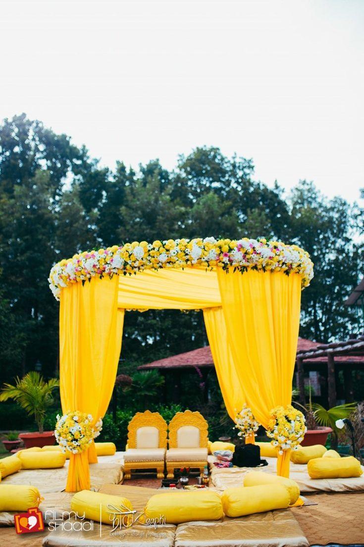 yellow mandap canopy with flowers | Vintage Boho Hindu Wedding Dehradun | PhotozAapki | the big fat indian wedding inspiration www.thebigfatindianwedding.com