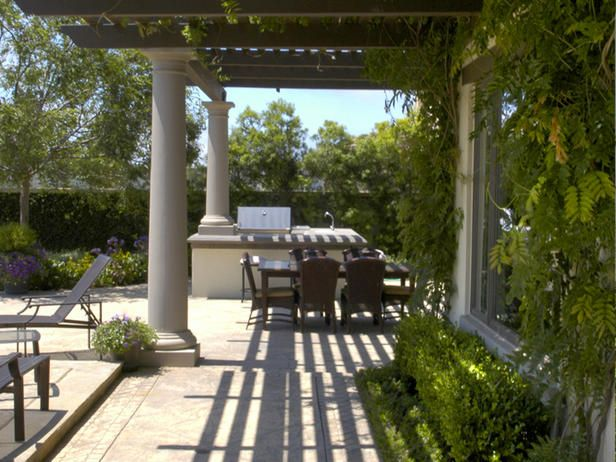 A large wisteria-covered pergola lines the side of the pool and provides much-needed shade for the homeowners and guests to relax in the hot Los Angeles summer weather.