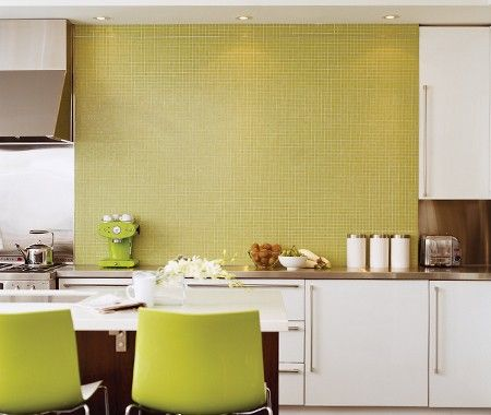 Green Tiled Kitchen      Contemporary lines with a splash of springtime colour.    Chairs with high-gloss green plastic backs complement this space's sleek look and are easy to clean — making them ideal for children. A porcelain mosaic tiled wall breaks up the abundance of stainless steel and glossy white cabinetry in the kitchen.