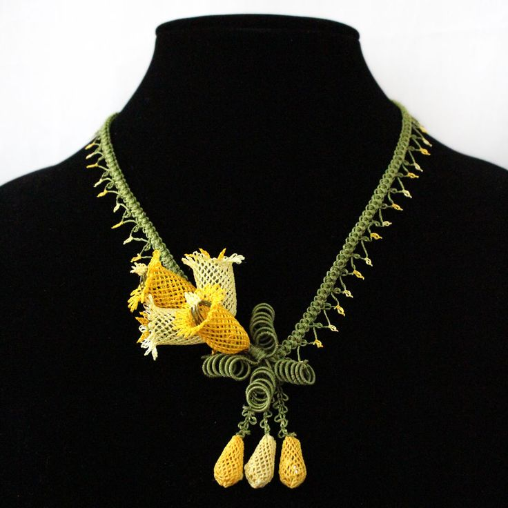 For the woman with a statement to make this crochet Bell shaped flower necklace with bud drops is perfect accessory for a gala or ball. Pair it with a strapless evening gown or a knit top. Resting at the bust line with comfortable ease this intricate oya necklace comes with a lobster clasp