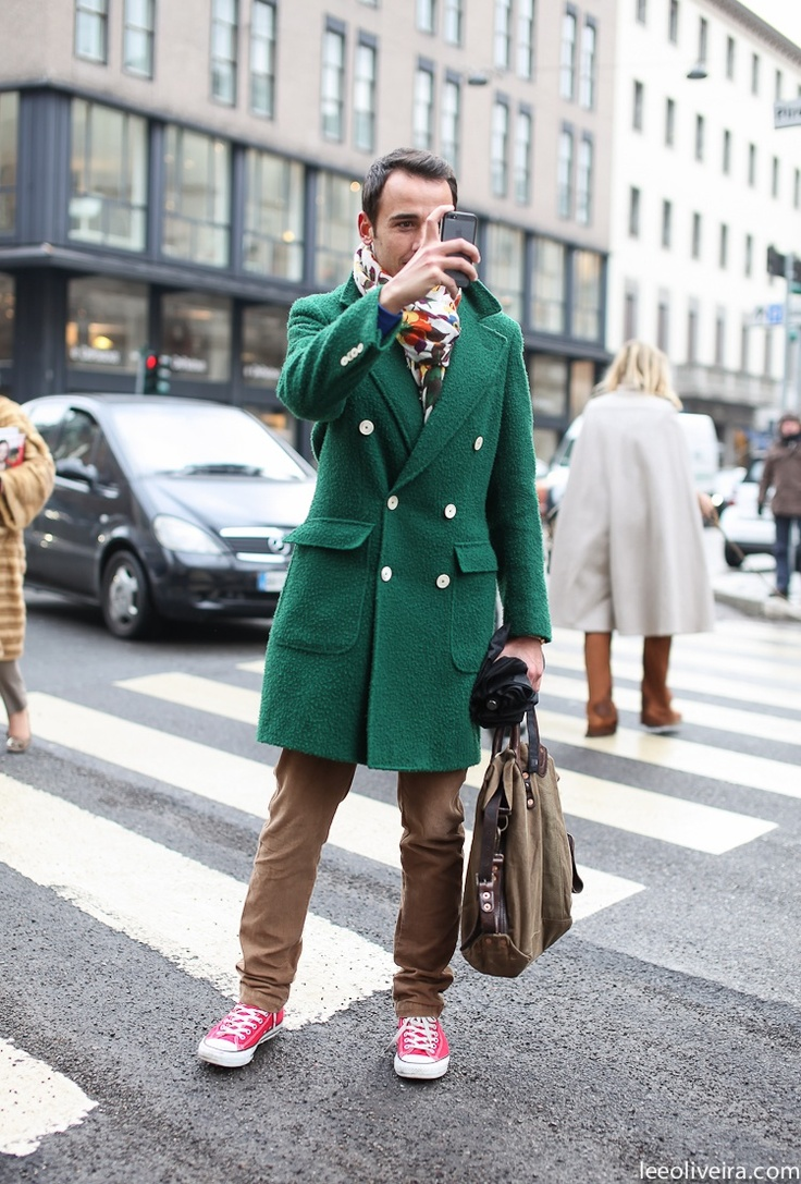 Perfect the smart casual look in a green overcoat and brown chinos. Deep  pink low top sneakers will add some edge to an otherwise classic look.