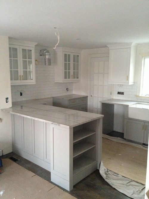 Cabinets painted in Cape May Cobblestone by Benjamin Moore.  Very nice mid to light gray.