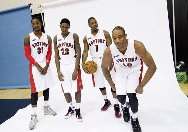 Toronto Raptors, from left to right, Terrence Ross, Lou Williams, Kyle Lowry, and DeMar DeRozan joke around while posing for photos at the team's media day at the Air Canada Centre in Toronto on Monday, September 29, 2014. (Darren Calabrese/THE CANADIAN PRESS)