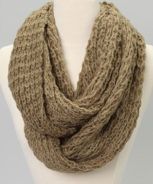 Take that outfit up a notch with this scarf! This trendy piece features a chunky knit in an endless loop.