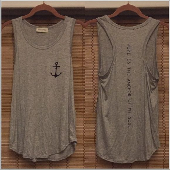 """Anchor tank top Grey/navy nautical tank top. It's a loose fitting style, with a rounded hem and racer back. The front has an anchor on the left chest area and the back says """" Hope Is the anchor of my soul"""" written down the spine area. Never worn. Size S. Tops Tank Tops"""
