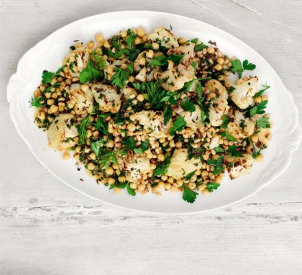Roast cauliflower with cumin and caraway then serve with healthy chickpeas and herbs in this Middle Eastern-style salad
