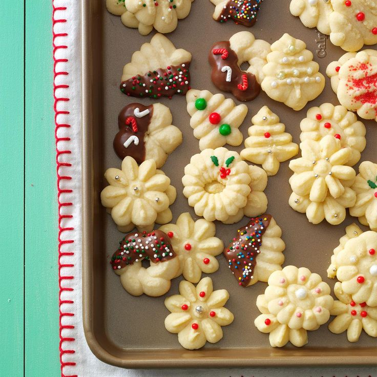 Buttery Spritz Cookies Recipe -These tender little cookies are very eye-catching on my Christmas cookie tray. The dough is easy to work with, so it's fun to make these into a variety of festive shapes. —Beverly Launius, Sandwich, Illinois