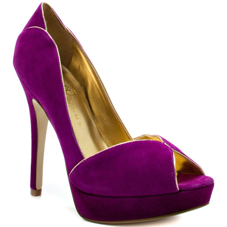You deliver a classic stylish pump, so why not indulge with the Aliza. This Ivanka  Trump style brings you a rich purple suede with accenting gold piping.