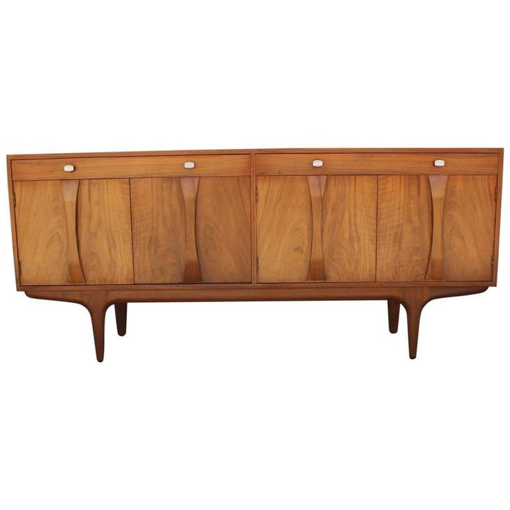 Sculptural Walnut Sideboard with Chrome Hardware   From a unique collection of antique and modern credenzas at https://www.1stdibs.com/furniture/storage-case-pieces/credenzas/