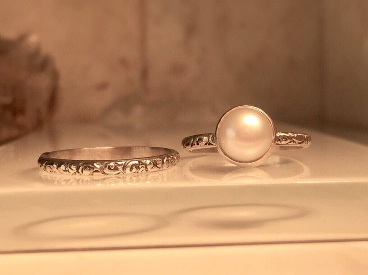 A personal favorite from my Etsy shop https://www.etsy.com/listing/483161306/handmade-pearl-ringsolitare-pearl