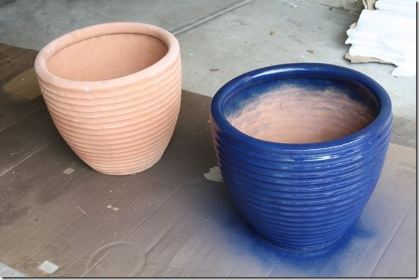 How would you like to have some of those really big and expensive flower pots at a fraction of the cost?? Grab a couple of the large terracotta pots and some Rustoleum gloss protective enamel spray paint in whatever color your pretty little heart desires, and go to town with them. Make sure there are holes for drainage on the bottom before you fill them up........D.