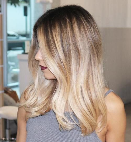 medium hair with balayage highlights and dark roots: