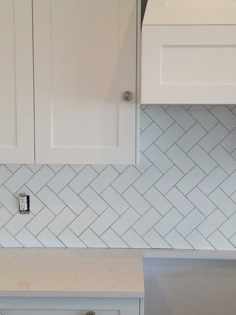 White Subway Tile In Herringbone Pattern White Caesarstone Offwhite Cabinets Flourish