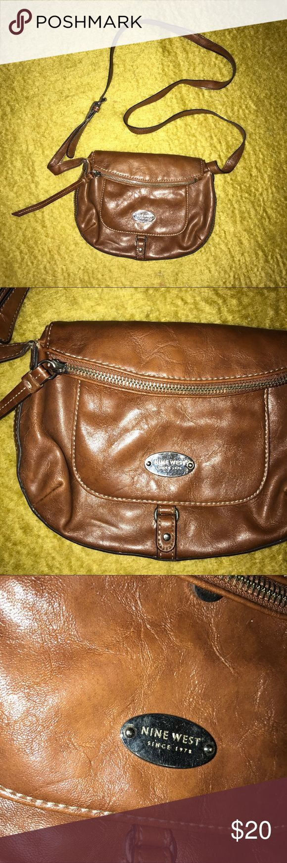 Vintage Nine West Crossbody Faux Leather Brown Bag Nine West faux leather crossbody zip up mini purse fits nicely over the shoulder and is a great addition to your handbag collection! Has a magnetic snap closure with a main pocket that stretches out to unzip. Also features a classic Nine West nameplate. Adjustable straps. In thrifted condition. Nine West Bags Crossbody Bags