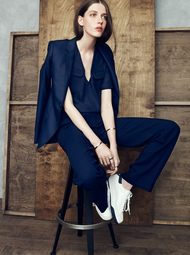 J.Crew Collection. Navy blue ladies cape suit with white sneakers