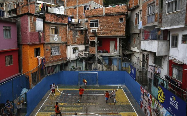 People take part in a football match held at the Tavares Bastos slum in Rio de Janeiro. The World Cup will be held in 12 cities in Brazil from June 12 till July 13.Picture: REUTERS/Pilar Olivares