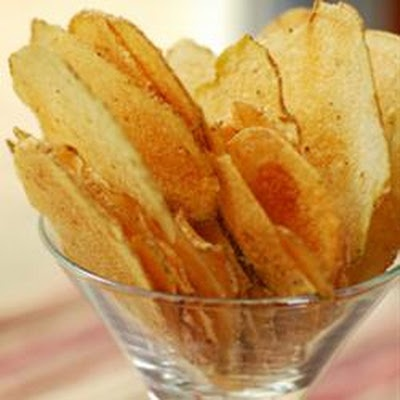 Microwave Potato Chips- This really does work! I sliced a potato on my mandoline, rinsed then spinned them dry in the salad spinner (to remove starch), then coated ever so lightly with olive oil and a sprinkle of salt. Laid them out on a paper plate and microwaved 2 1/2 minutes to perfection! Crispy, salty and not greasy! I'm guessing same calorie count as a med. potato? BARGAIN!