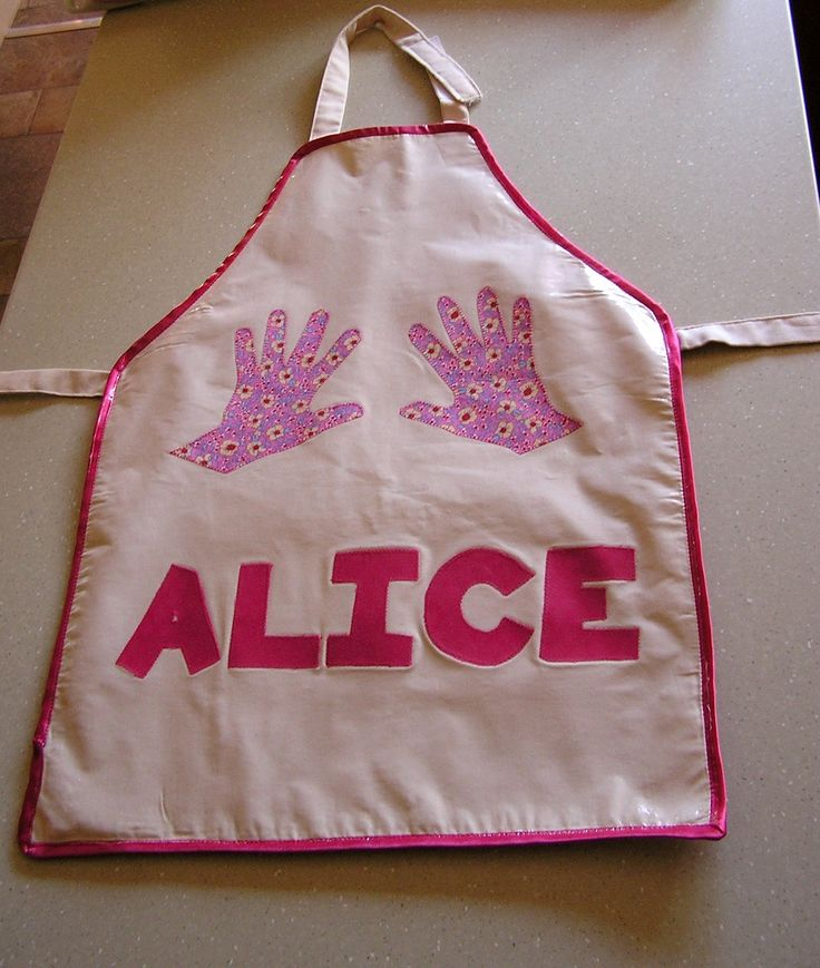 Created for my daughter using her handprints as templates.  Covered with iron-on vinyl to make it easy to clean