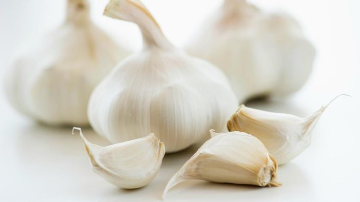 Grow garlic from cloves by breaking a garlic bulb apart into separate cloves without removing the husk, choosing a location with full-sun exposure and loamy soil and placing the cloves with the...