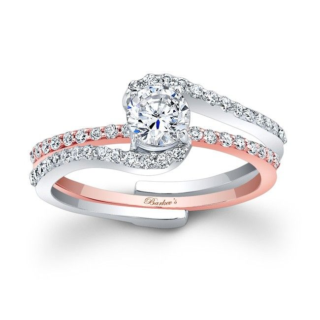 this classic two tone rose and white gold interlocking diamond wedding ring set features a prong set round diamond center - Interlocking Wedding Rings