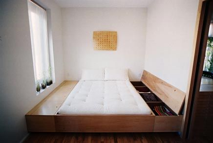 Love this! A bedroom with just one piece of furniture: the bed! (and some storing space underneath) (and a piece of art on the wall) (but that's really it ;-)