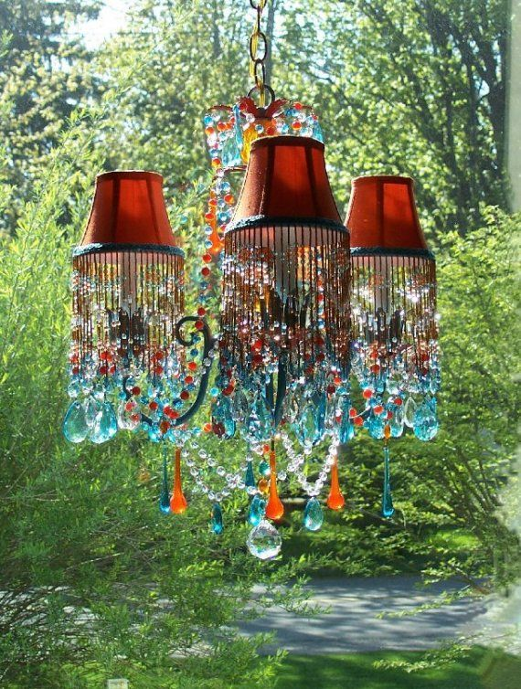 Striking hand~crafted petite chandelier that captures all the vibrancy of a breathtaking sunset over deep ocean waters.    Three~arm chandelier,