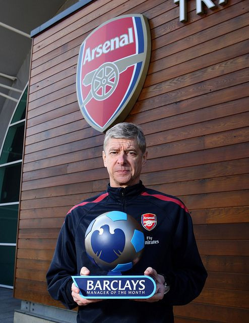 Arsenal manager Arsene Wenger with the Barclays Manager of the Month award for February 2011