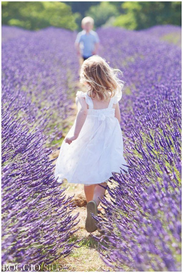 Child running through lavender fields