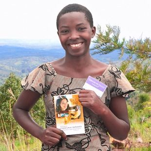 A beautiful young sister in Burundi holding a book translated by Jehovah's Witnesses - Jehovah's Witnesses have made their literature available in over 600 languages and dialects.  Visit jw.org