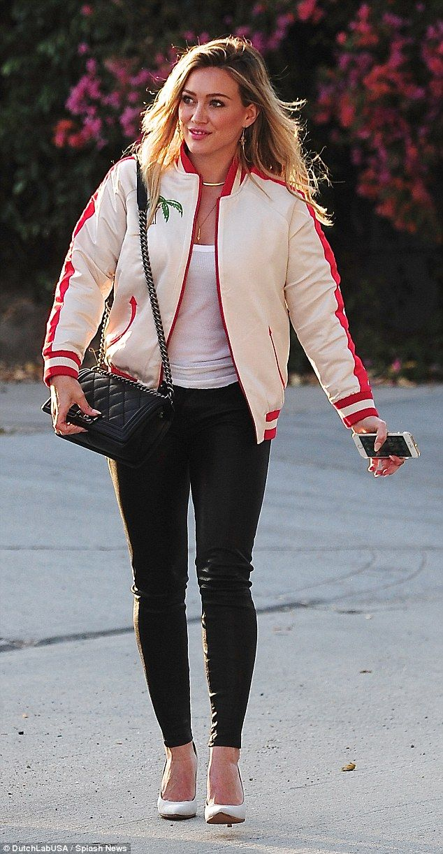 Stepping to the studio: Hilary Duff had a smile on her face as she headed to an in studio ...