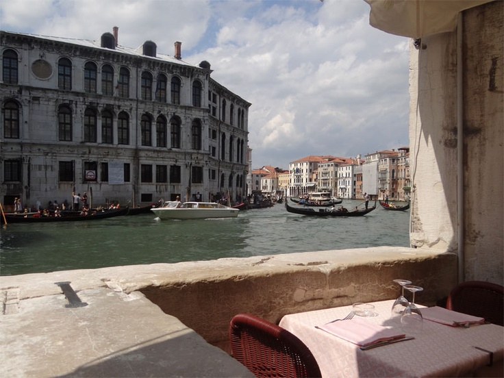 Beautiful view from a restaurant next to the Rialto Bridge.