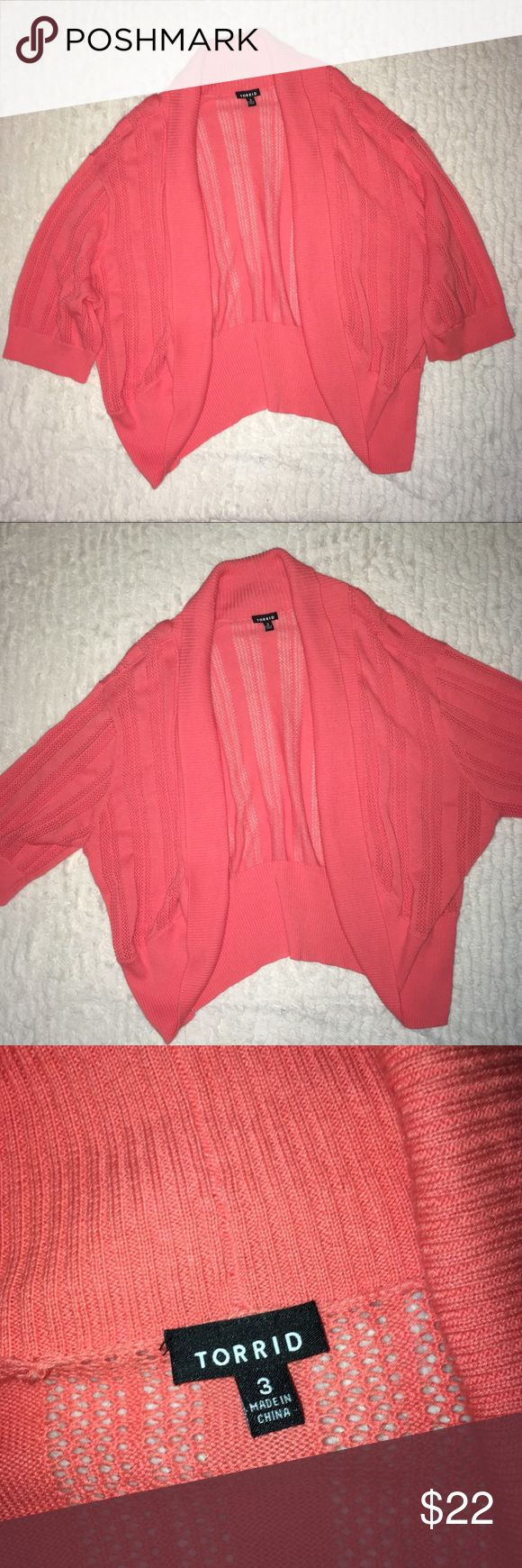 Torrid coral open knit shrug sweater size 3 Torrid coral open knit shrug sweater size 3. Length measures approximately 24 inches. So cute over tops and dresses. torrid Sweaters Shrugs & Ponchos